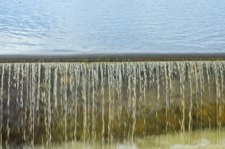 Overflow water over side channel spillway