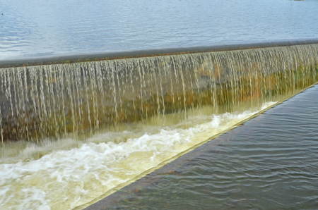 Strong overflow at side channel spillway Stock Photo