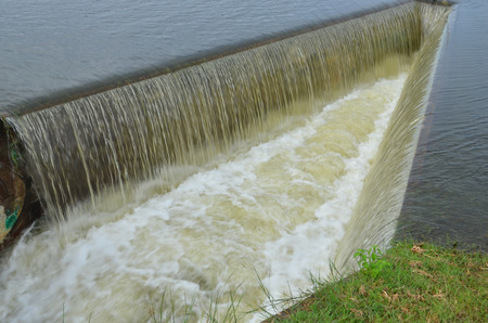 Strong waterfall from side channel spillway