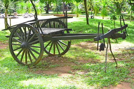 Old black cart shows in outdoor museum