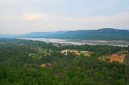 Wide river in green tropical forest and range in Asia