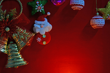 Beautiful Christmas decoration in the light on red background Imagens