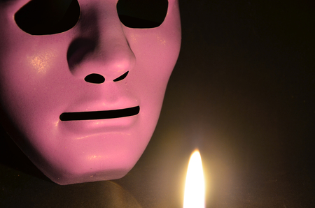 Scary violet mask of hollow man in the light