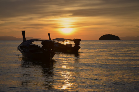 Passenger boats in scintillation sea in the evening Imagens