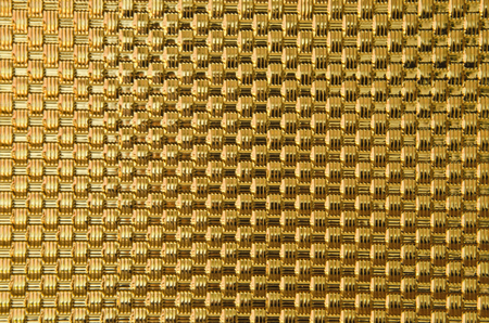 Scintillation pattern of golden woven metal bars