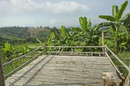 Bamboo balcony with fence and banana trees on the mountain