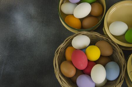 Basket and bowls of colored eggs top view Stok Fotoğraf