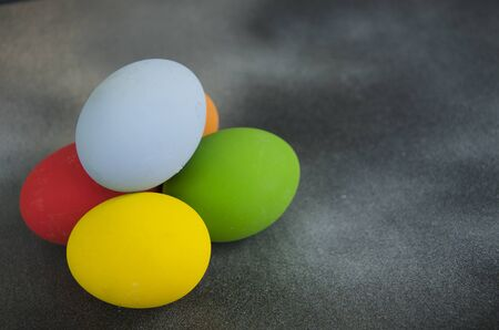 Small heap of beautiful colored eggs