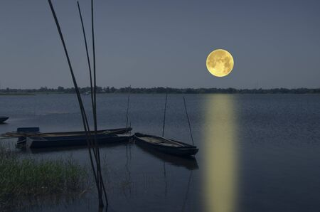 Beautiful full moon over the lake in the evening