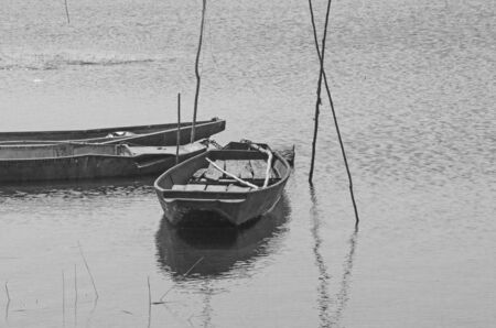 Black and white image of boats in the water