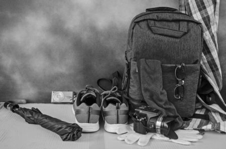 Black and white image of travel materials and tools