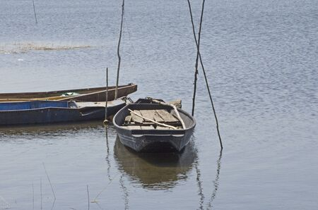 Fisherman boats and poles in the water