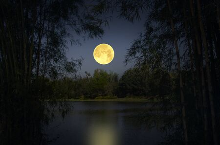 Big moon with reflection in the river Stock Photo