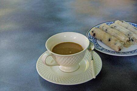 Coffee cup with glutinous rice roasted in bamboo joints