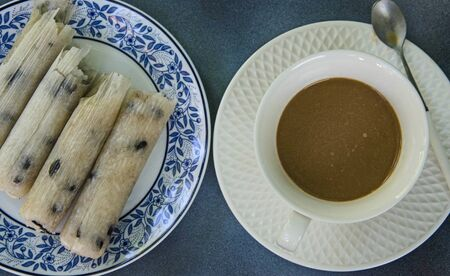 Glutinous rice roasted in bamboo joints and coffee cups 写真素材