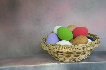 Woven rattan basket of colored eggs