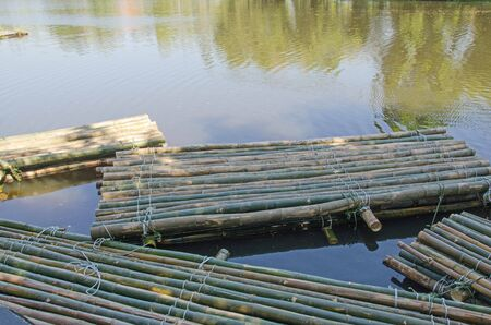 New green bamboo rafts in the water of lake 版權商用圖片