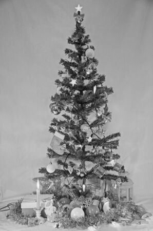 Black and white Christmas tree with decorations Imagens