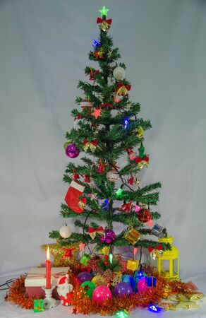 Christmas tree with beautiful ornaments for celebration Imagens