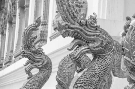 Black and white images of naga sculptures