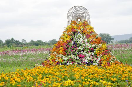 Road of beautiful flowers to high woven bamboo goal