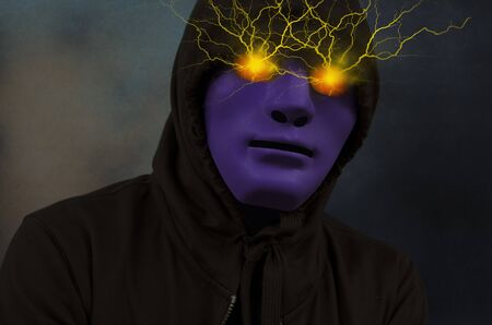 Violet mask man with electric power in eyes