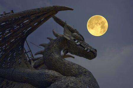 Big gold iron dragon with big moon in the night