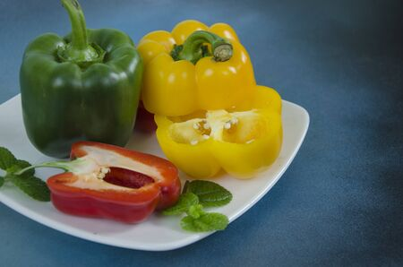 Sweet pepper detail dish with blue background Imagens - 130782372