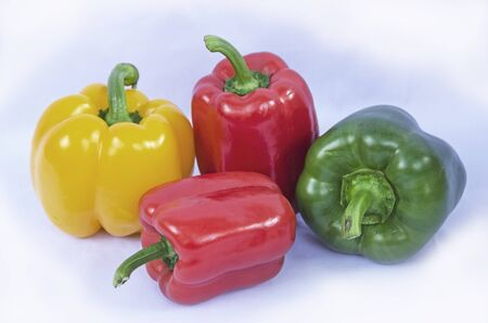 Beautiful sweet peppers on white background Imagens - 130782383