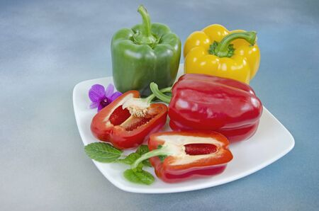 Beautiful sweet pepper dish on blue floor Imagens - 130782452