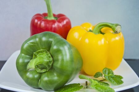 Beautiful sweet peppers and leaves close up Imagens