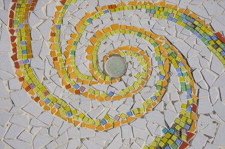 Spiral colored ceramic scrap pattern from center