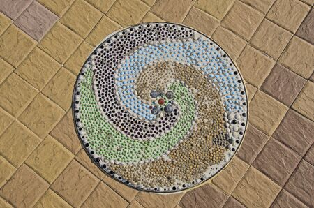 Top view of beautiful colored spiral pebble pattern