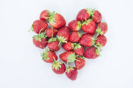Red strawberry heart on white background