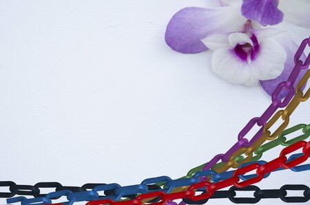 Colored chains and beautiful violet flower Banque d'images