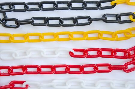 Arts of colored plastic chain lines on white background