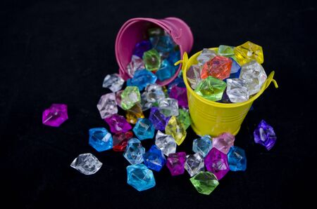 Glass marbles in buckets and on the floor