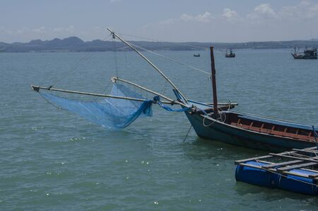 Fisherman boat with mesh in the sea