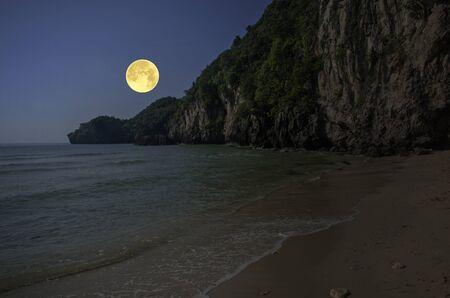 Beautiful beach in full moon light in the evening Archivio Fotografico