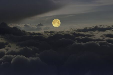 Beautiful full moon over black clouds