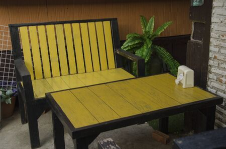 Yellow chair and table on the floor Banco de Imagens