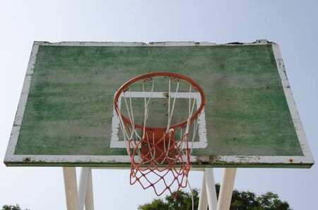 Old wooden basketball hoop on sky background Banco de Imagens