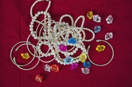 Top view of pearl necklaces and bracelets with gems