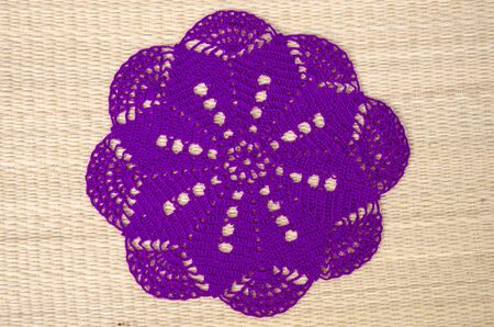 Beautiful violet clothes coasters on papyrus mat floor Imagens - 134394233