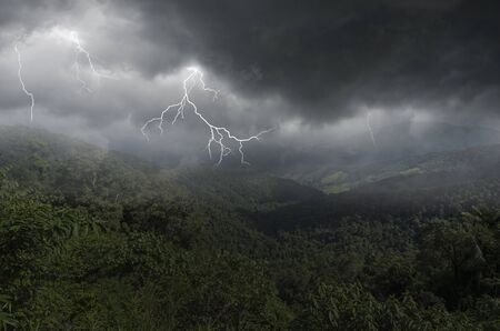 Thunder and lightning storm over deep valley and mountains Imagens - 134478208