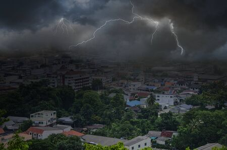 Scared cyclone storm with dangerous lighting in a city Imagens - 134478211