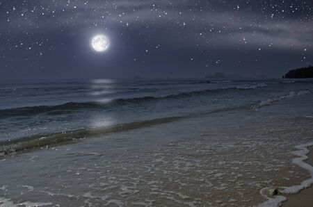 Beautiful lonely beach with full moon in the night