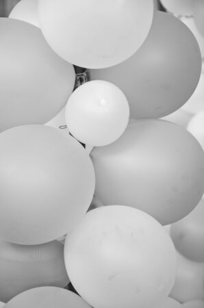Black and white image of balloon skins close up Imagens