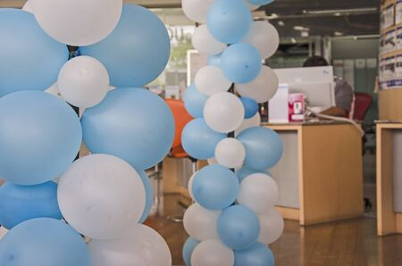Blue and white balloon decoration in an office