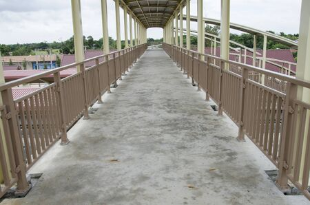 Long concrete floor and fences of bridge over the building